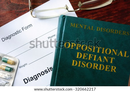 Oppositional Defiant Disorder Concept Diagnostic Form And Book On A Table