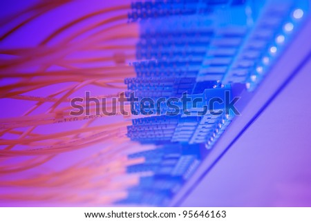 optic fiber cables connected to an optic switch - stock photo