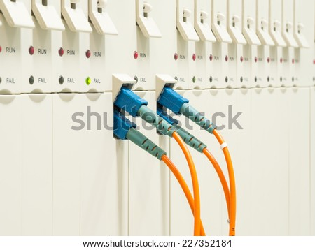 optic fiber cables connected to transmission Controler - stock photo