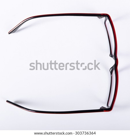 optical red glasses on a light gray background closeup view from above - stock photo