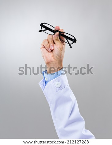 Optician hand with eye glasses - stock photo