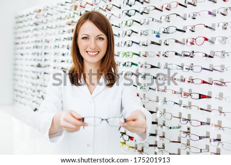 Optician presenting  eyewear frames