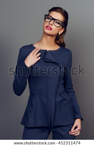 Optics style. Portrait of a beautiful young woman wearing elegant suit and glasses. Beauty, fashion. Cosmetics, make-up. - stock photo