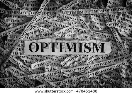 Optimism. Torn pieces of paper with the word Optimism. Concept Image. Black and White. Closeup.