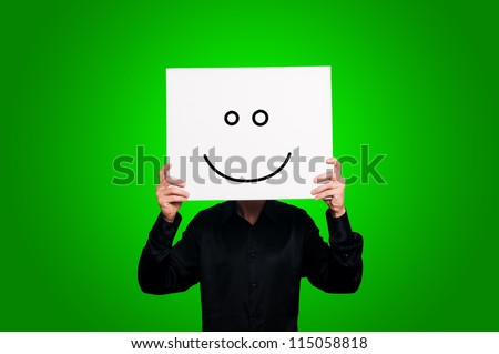 optimist person with sign and black shirt on green background