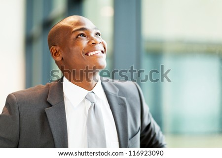 optimistic african american businessman looking up - stock photo
