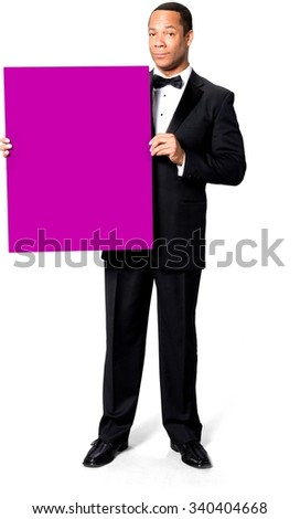 Optimistic African man with short black hair in evening outfit holding large sign - Isolated