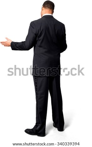 Optimistic African man with short black hair in evening outfit with arms open - Isolated