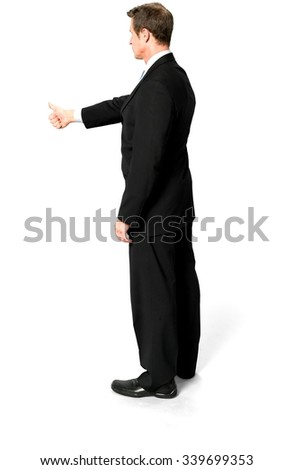 Optimistic Caucasian man with short black hair in business formal outfit giving thumbs up - Isolated