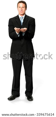 Optimistic Caucasian man with short black hair in business formal outfit holding invisible object - Isolated - stock photo