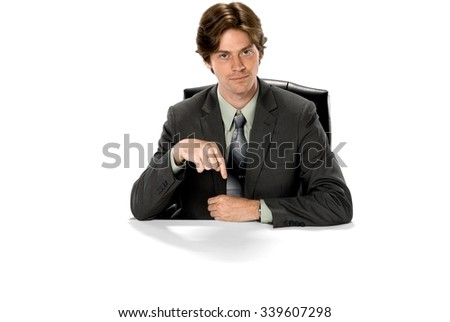 Optimistic Caucasian man with short dark brown hair in business formal outfit pointing using finger - Isolated