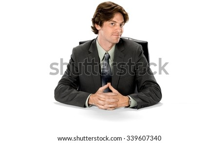 Optimistic Caucasian man with short dark brown hair in business formal outfit with clasped hands - Isolated