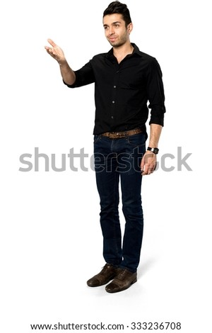 Optimistic Caucasian man with short dark brown hair in casual outfit pointing using palm - Isolated