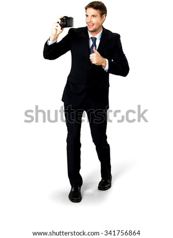 Optimistic Caucasian man with short medium blond hair in business formal outfit using camera - Isolated - stock photo