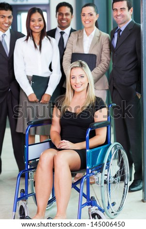 optimistic disabled young businesswoman and team - stock photo