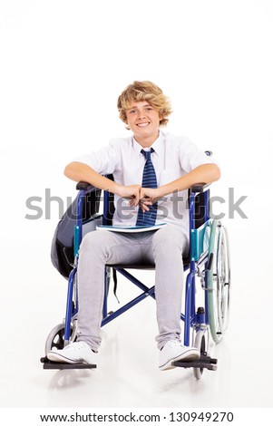 optimistic handicapped high school student sitting on wheelchair - stock photo