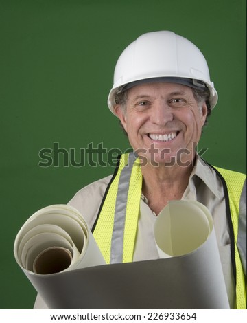 Optimistic looking senior construction man/Serious Construction Worker/Senior man with hard hat with positive attitude - stock photo