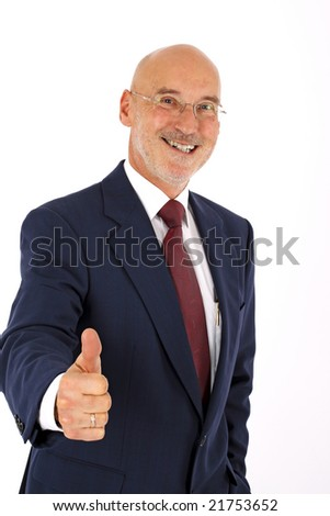 optimistic senior businessman showing a thumb up and smiling (isolated on white)