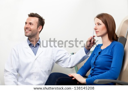 Optometrist doing sight test for female pateient - stock photo