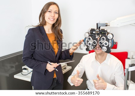Optometrist during an eye exam - stock photo