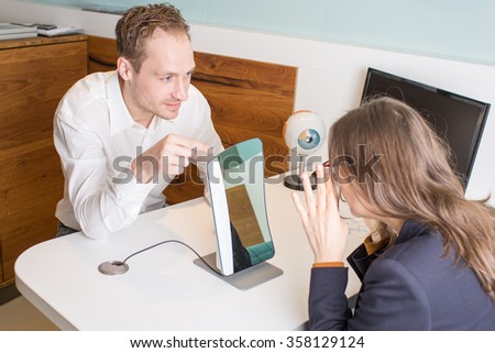 Optometrist during lens measurement with a centration system - stock photo