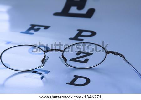 optometrist eye test chart blue - stock photo