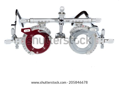 Optometrist's old test glasses, isolated on white background. - stock photo