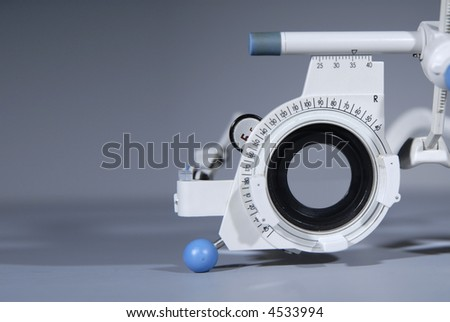 Optometrist's trial frame close detail with trial lenses for eyetest - stock photo