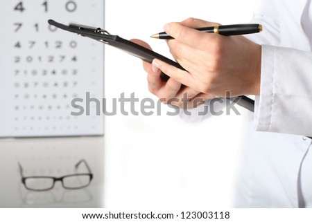 Optometrist with notes, examination, isolated white background - stock photo
