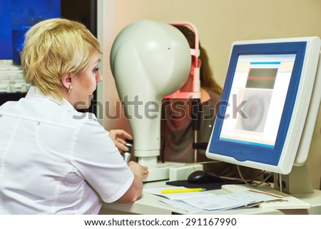Optometry concept. female optometrist optician doctor evaluate eyesight of female patient in eye ophthalmological clinic  - stock photo