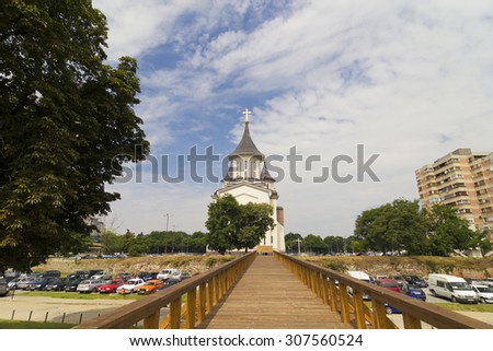 ORADEA, ROMANIA, CIRCA JULY 2015 : The bridge and the Orthodox Episcopal Cathedral, Resurrection of Oradea, Romania