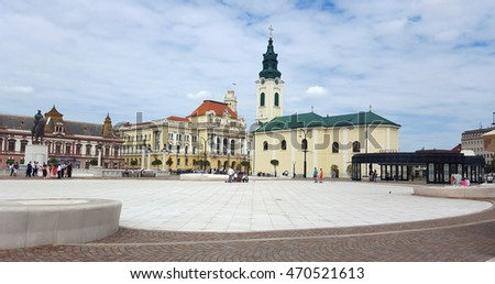 ORADEA, ROMANIA - 08.14.2016: Union square and Roman Catholic Church landmark architecture