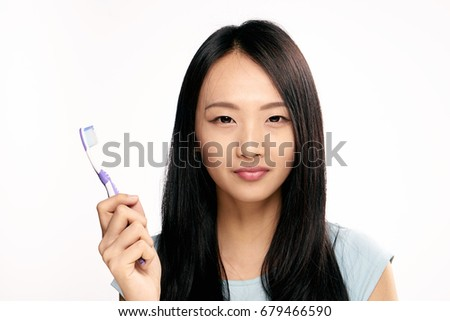 Oral care, asian woman with toothbrush on isolated background portrait