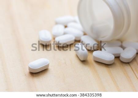 Oral medicine, paracetamol,white pills. drug. medicine. - stock photo