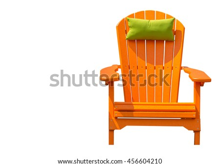 orange adirondack chair isolated orange adirondack chair with green head rest pillow against white background