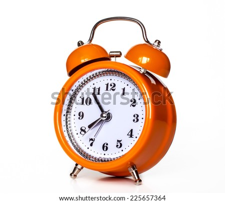 Orange alarm clock on white background. Colorful morning mood. Happy hours. Good morning. - stock photo