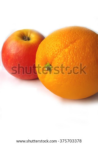 Orange and apple on a white background.