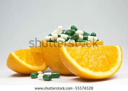 Orange and capsule - stock photo