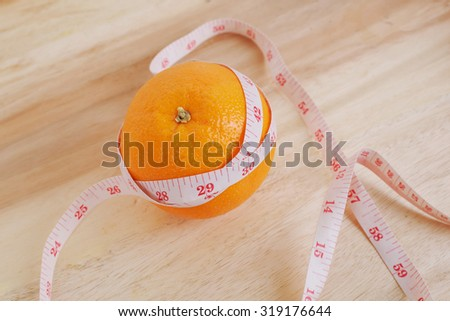 orange and centimeter for lose weight concept - stock photo