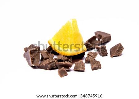 Orange and chocolate isolated on white - stock photo