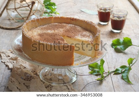 Orange and Cinnamon Cheesecake on a Rustic Wooden Background. Selective Focus - stock photo