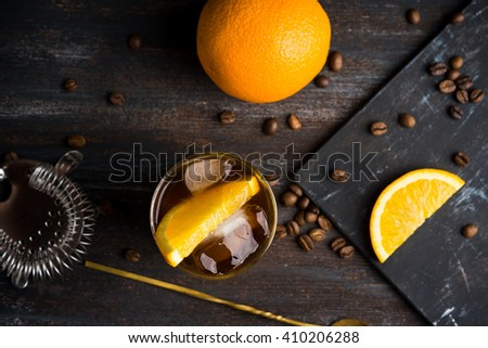 Orange and coffee cocktail on the wooden background. Shallow depth of field. - stock photo