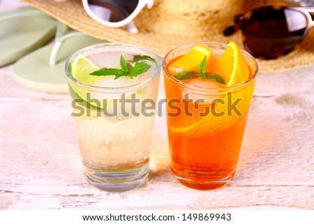 Orange and elderflower cocktails with holiday background, close up