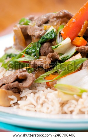 orange and ginger beef stir fry over brown rice