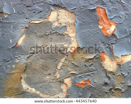 orange and gray tones texture of shabby paint and plaster crack