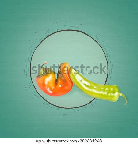 Orange and green pepper on art background - stock photo