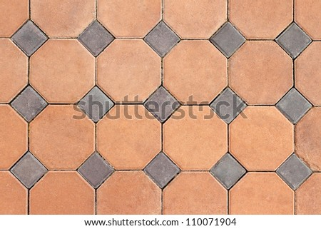 Orange and grey concrete pavings block pattern texture - stock photo