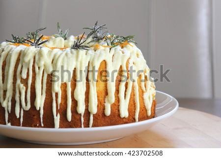 Orange and rosemary bundt cake - stock photo