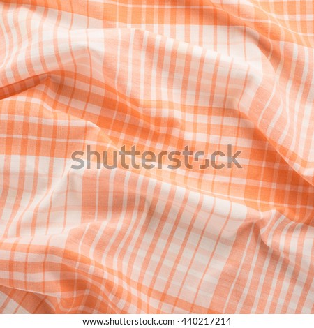 Orange and white tablecloth background  - stock photo