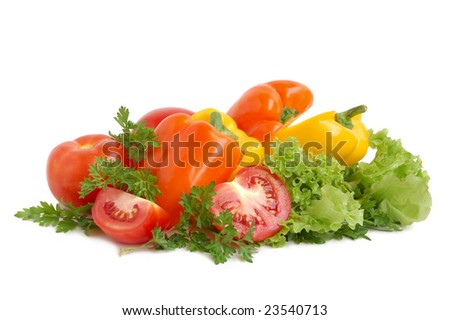 Orange and yellow bell peppers, tomatos, lettuce and parsley on white background